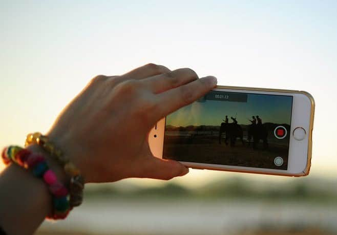 person taking video on phone