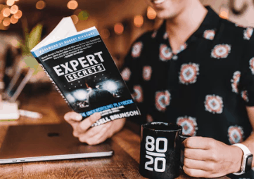 Entrepreneur reading expert secrets book